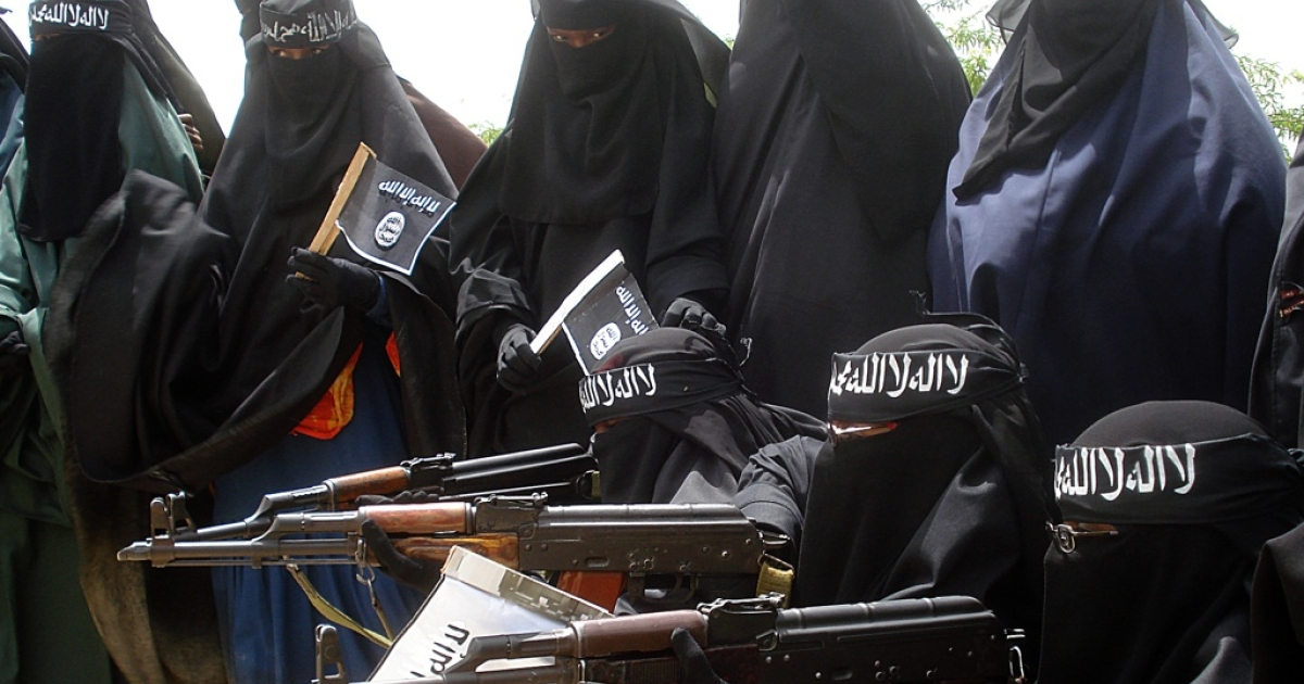 American Omar Hammami, known as Al Amriki, is fighting in Somalia with the radical Islamic group, Al Shabaab. Here Somali women in a demonstration by Al Shabaab rebels on July 5, 2010. The demonstrators were carrying placards written with slogans against the African Union peacekeeping force.</p>