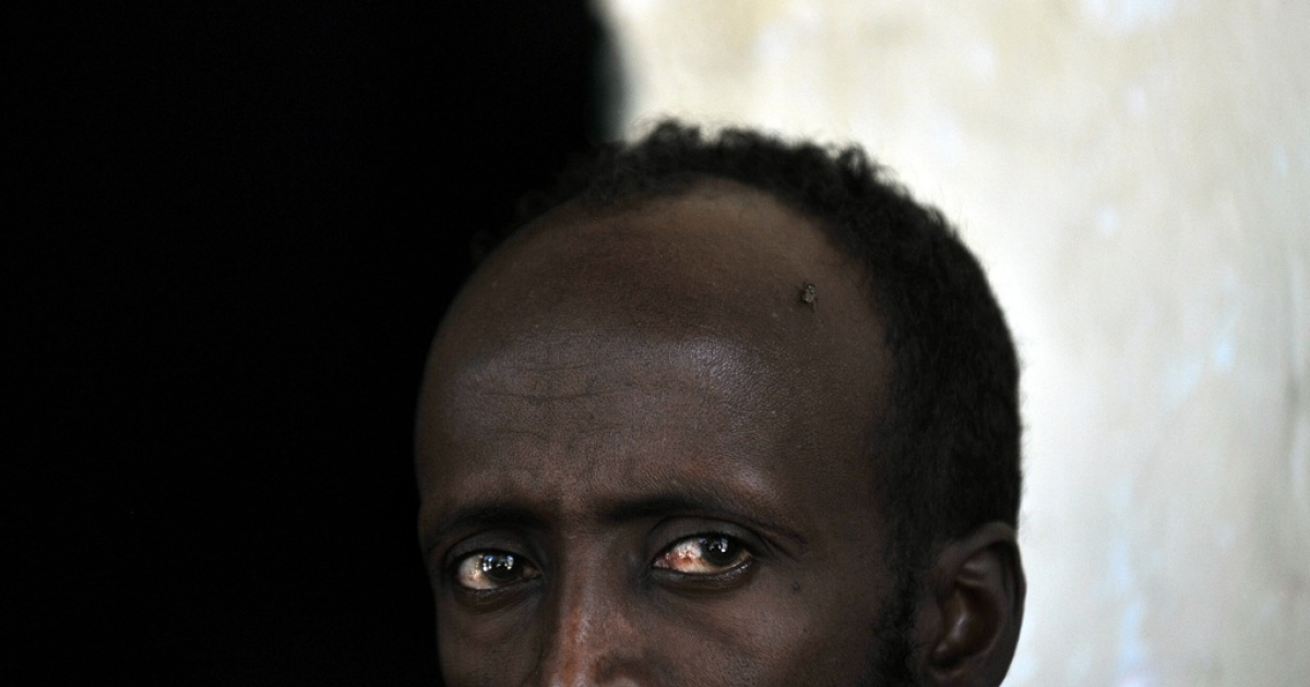 A Somali man convicted of piracy looks on at the Berbera prison in Somalia's breakaway republic of Somaliland.</p>