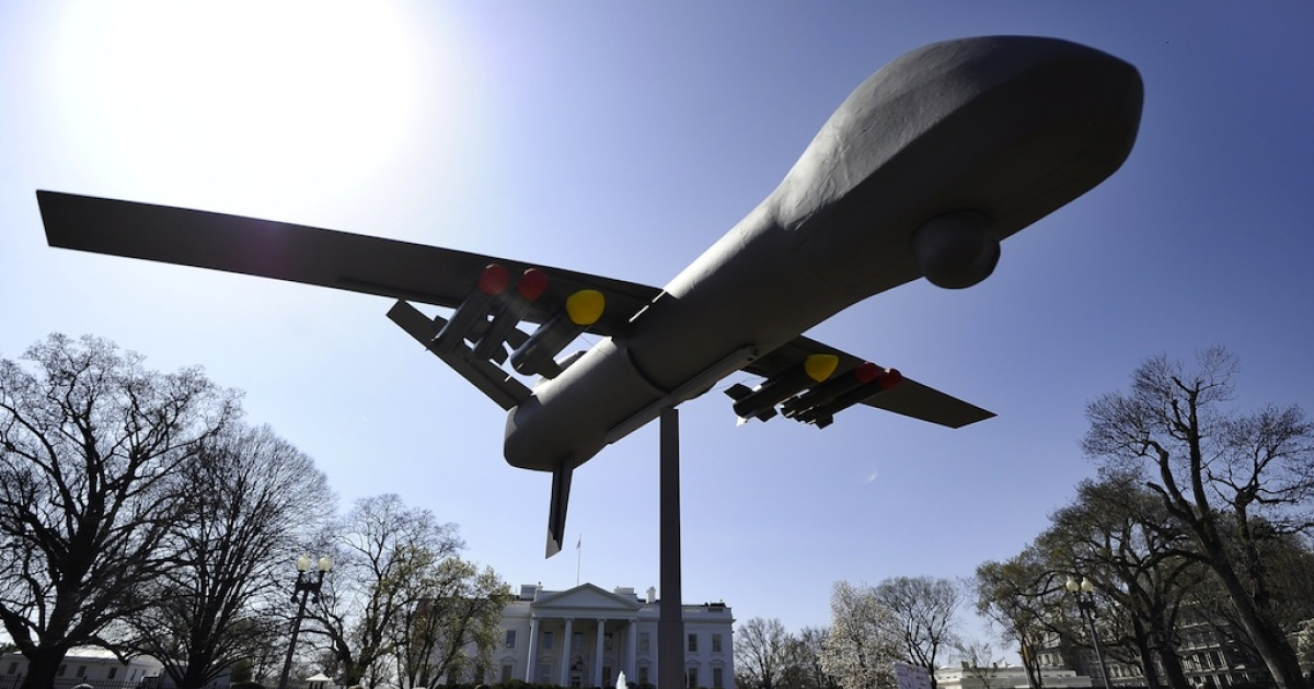 Anti-war protesters displays an effigy of an attack drone as they take part in a demonstration in front of the White House in Washington, DC, on Mar. 19, 2011.</p>