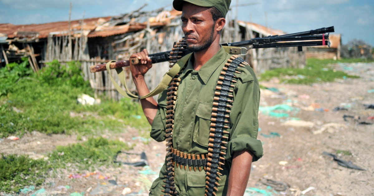 A fighter allied with the Federal Government of Somalia is pictured in Burgabo, Southern Somalia on December 14, 2011. The Somali president's convoy was ambushed by Al Shabaab rebels on May 29, 2012, but President Sheikh Sharif Sheikh Ahmed escaped unharmed.</p>