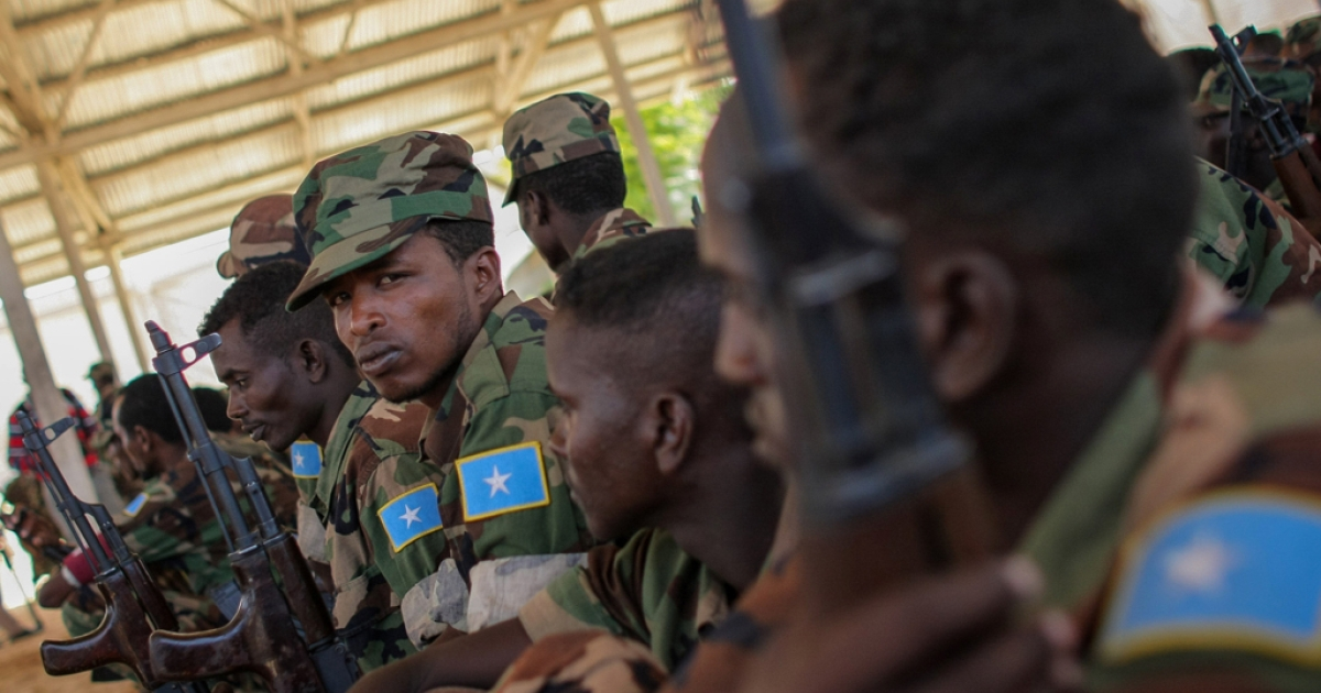 Recently trained members of the Somali National Army (SNA) sitingt during a passing-out parade at an African Union Mission in Somalia (AMISOM) training facility on the western fringes of Mogadishu. The SNA has helped liberate large areas and towns of strategic importance across Somalia from the Al-Qaeda-affiliated terrorist group Al Shabaab.</p>