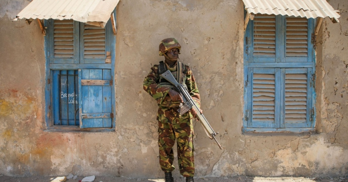 A soldier of the Kenyan Contingent serving with the African Union Mission in Somalia (AMISOM) stands guard on a street in the centre of the southern Somali port city of Kismayo while a combat engineering team inspects the surrounding area following reports of a suspected improvised explosive device (IED) left behind by the Al-Qaeda-affiliated extremist group Al Shabaab.</p>