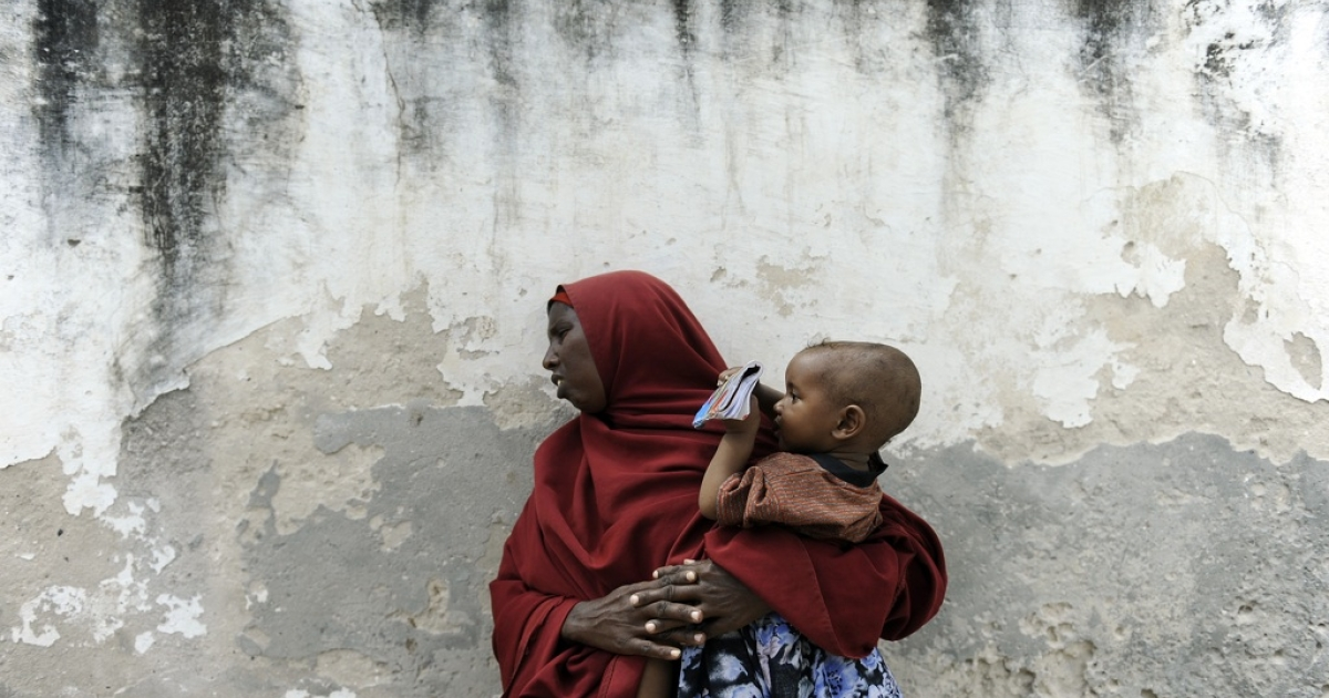 A resident of Mogadishu waits with her child at an Africa Union peacekeeping mission in Somalia (AMISOM) clinic on Oct. 5, 2011.</p>