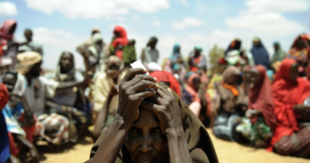 A newly arrived elderly Somali woman waits with others new arrivals to be registered as refugees in Doolow, south western Somalia. Doolow is the main exit point for Somalis from Bay, Bakool and Gedo regions fleeing to Ethiopia to escape war and a severe drought currently ravaging the country, with the UN declaring famine in six Somali regions.</p>