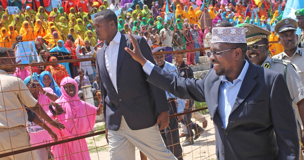 The president of Somalia Sheikh Sharif Ahmed waves to hundreds of Mogadishu residents at a ceremony north of the capital on August 6, 2012. Somalian MPs elected Hassan Sheikh Mohamud as the next president on September 10, 2012.</p>