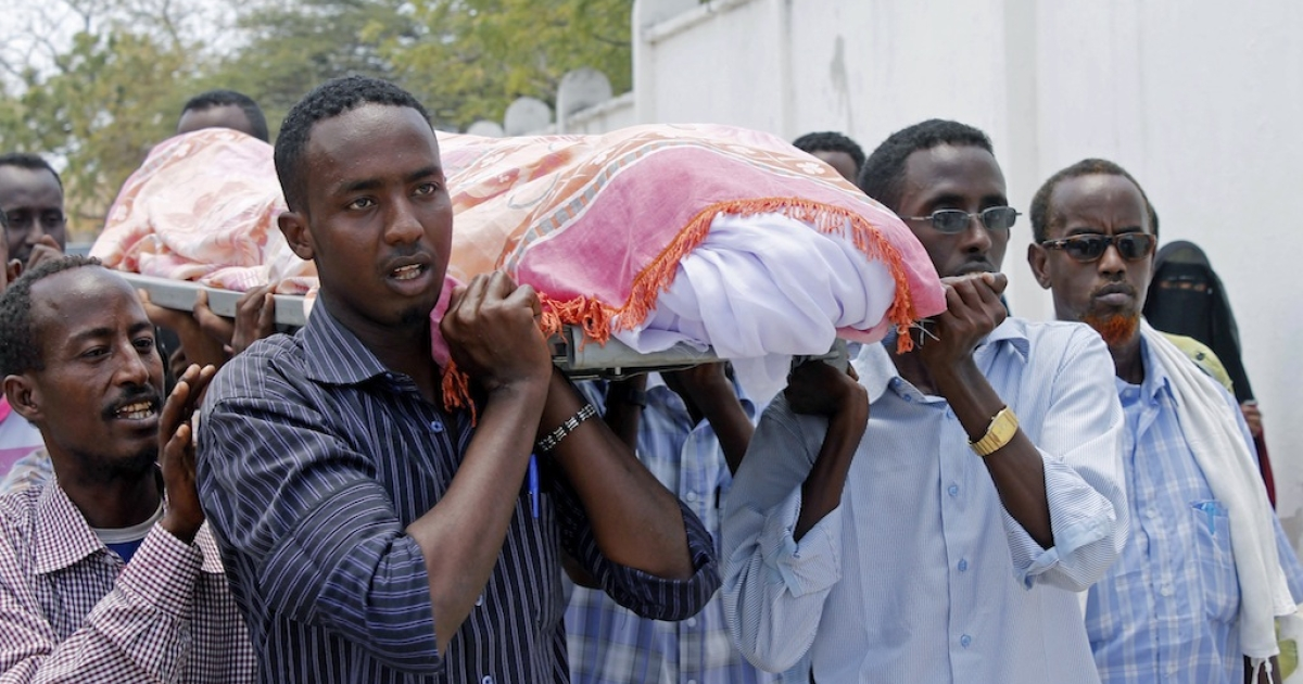 Somali people carry the body of journalist Abdisatar Dahir who was killed in a double suicide attack in a restaurant in Mogadishu. According to the International Press Institute, 16 journalists have been killed this year in Somalia, 119 total worldwide, the highest number since the 1990s.</p>