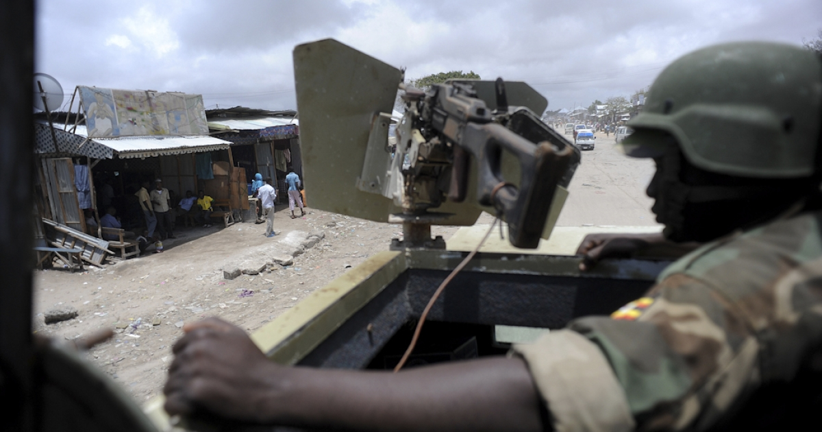 African Union peacekeepers patrol the outskirts of Mogadishu on September 12, 2012.</p>
