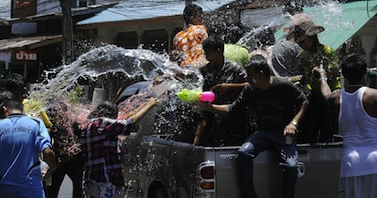 Splashing water during Songkran, a water festival marking the country's new year in Thailand's southern province of Narathiwat on April 13, 2012.</p>