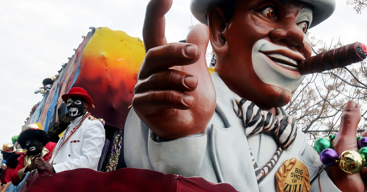 People dressed in blackface rode a float during the Zulu parade, a primarily African-American parade, during Mardi Gras festivities  in New Orleans, Louisiana, on Feb. 8, 2005.</p>