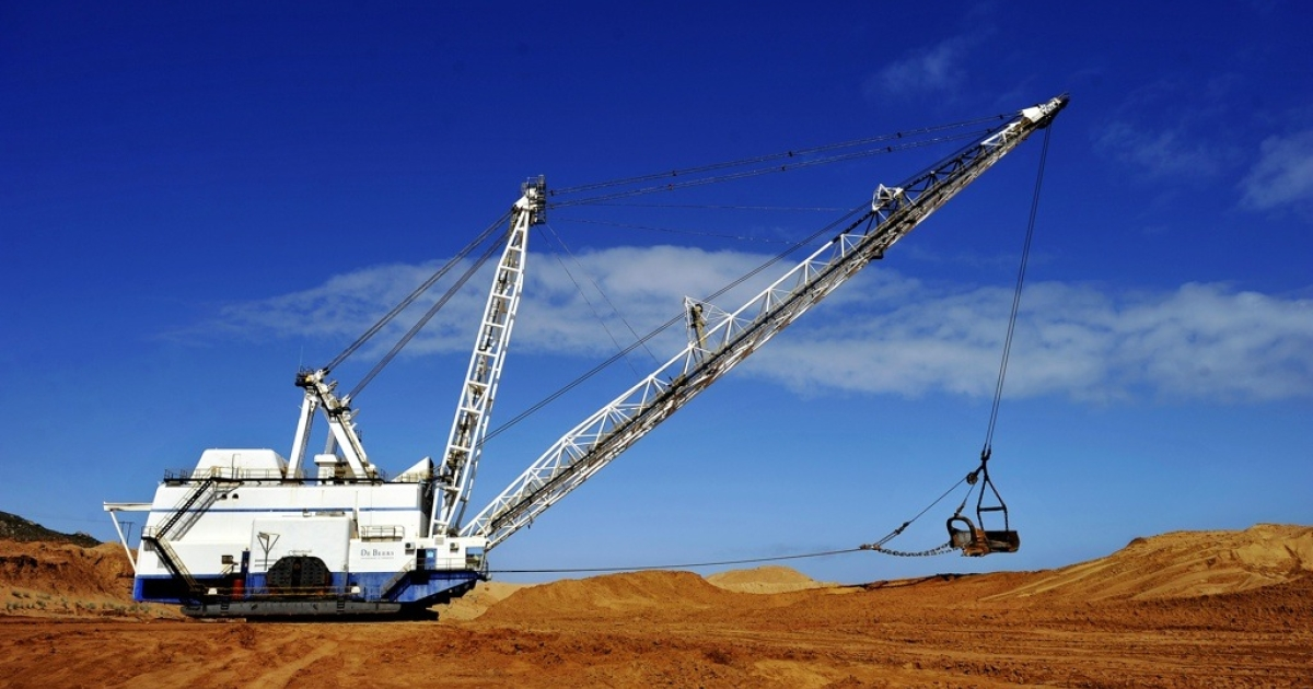 Earth moving equipment at a former diamond mine in Kleinzee, South Africa.</p>