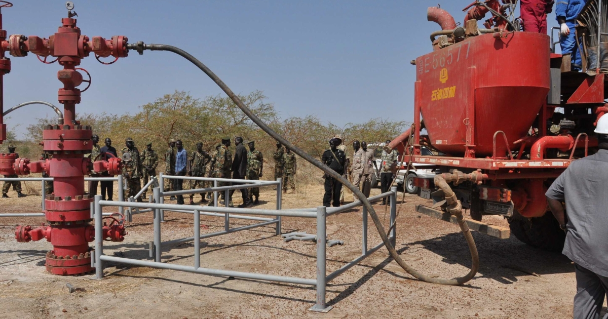 Workers at the Petrodar oil concession flush out remaining oil prior to a shutdown on oil production by South Sudan on January 29. The new nation has accused its neighbor Sudan of 'stealing' southern crude that runs through a pipeline to a northern port, sparking tensions between the two countries.</p>