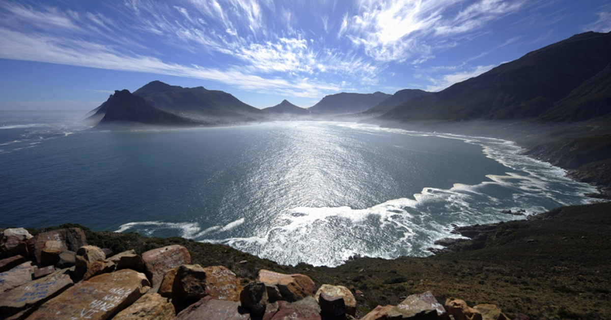 A general view of the Hout Bay harbour covered in mist is seen on May 8, 2010 from the Chapman's peak road on the outskirts of Cape Town. Chapman's peak road is the coastal link between Cape Town and the Cape of Good Hope. When following the African coastline from the equator the Cape of Good Hope marks the psychologically important point where one begins to travel more eastward than southward, thus the first rounding of the cape in 1488 by Portuguese explorer Bartolomeu Dias was a major milestone in the attempts by the Portuguese to establish direct trade relations with the Far East. He called the cape Cabo Tormentoso. As one of the great capes of the South Atlantic Ocean, the Cape of Good Hope has been of special significance to sailors for many years and is widely referred to by them simply as 'the Cape'. It is a major milestone on the clipper route followed by clipper ships to the Far East and Australia, and still followed by several offshore yacht races.</p>