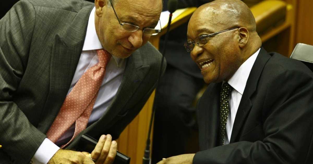 A case of black and colored. South African cabinet minister Trevor Manuel, left, talks with South African President Jacob Zuma in parliament. Manuel is one of South Africa's most prominent mixed race, or colored, politicians. Manuel is embroiled in a controversy over the status of the minority colored population versus the majority black Africans. (Nic Bothma/AFP/Getty Images)</p>