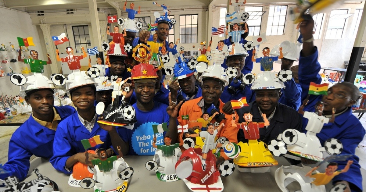 South African workers in a factory producing souvenirs for the World Cup 2011.</p>