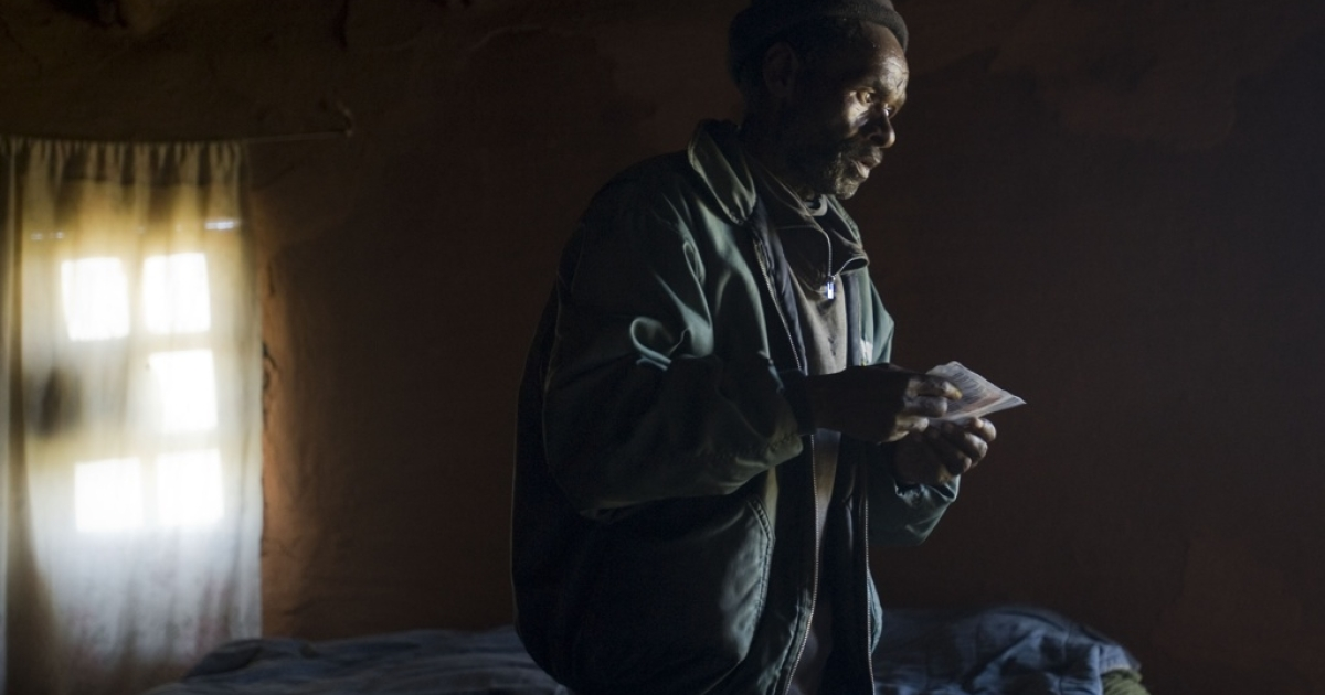 Former South African miner Vuyisile Gibson stands on November 8, 2011 in his mud hut near the town of Tsolo in the Eastern Cape province. He is undergoing tests to see whether his poor health is due to decades of breathing dust while working in Anglo American gold mines. Silicosis is caused by inhaling gold mining dust and can rest dormant for years before permanently scarring the lungs.</p>