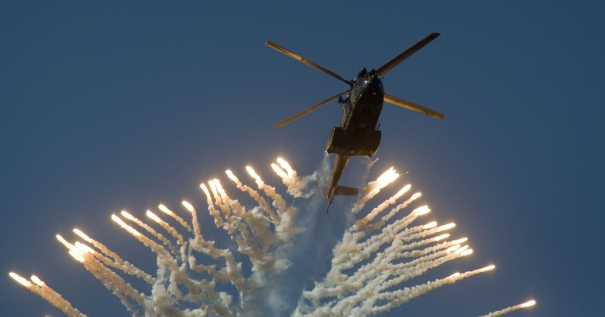 A lawsuit alleges that the South African MTN cell phone company promised to deliver South African military helicopters to Iran in exchange for a lucrative contract to operate a cell phone network in Iran. Here a South African Air Force helicopter fires flares during the Africa Aeronautics and Defence (AAD) Airshow, on September 24, 2010, in Cape Town.</p>