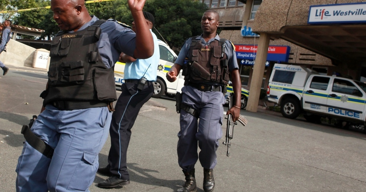 South African police cordon off the entrance of the Westville Hospital during a 5 hour hostage drama which unfolded in Durban on April 27, 2012. South Africa has a problem with corruption among its police.</p>