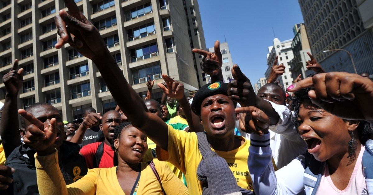 Supporters of African National Congress (ANC) Youth League leader Julius Malema sing outside the court in Johannesburg on September 12, 2011 that found Malema guilty guilty of hate speech for singing an anti-apartheid anthem whose lyrics mean 'shoot the white farmer.' After the verdict, some Malema supporters began singing it outside the court, in open defiance of the court order. No action was taken against them.</p>