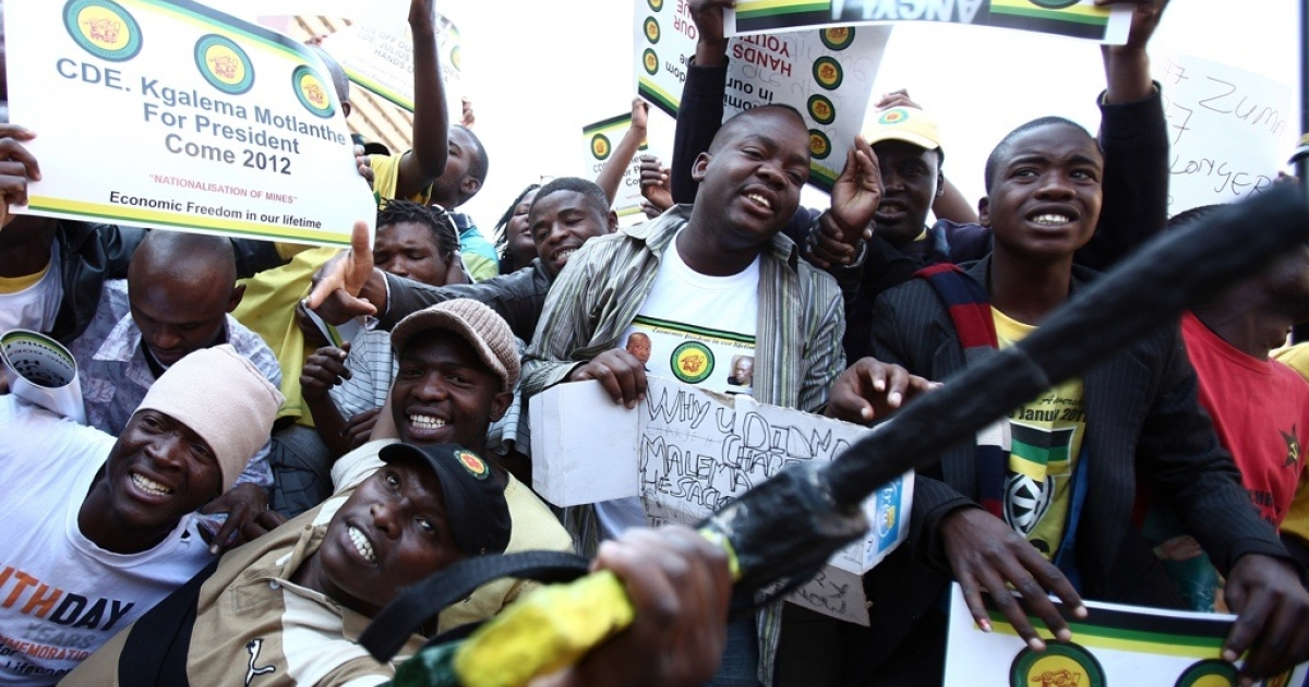 Supporters of the African National Congress (ANC) youth leader Julius Malema demonstrate for him on September 2, 2011 outside the ANC Luthuli house in Johannesburg during his disciplinary hearing. Hundreds of Malema supporters threw stones and bottles at police while burning the ruling party's flag and T-shirts bearing the face of President Jacob Zuma on August 30, 2011. Malema could be expelled from the ANC at the closed-door hearing.</p>