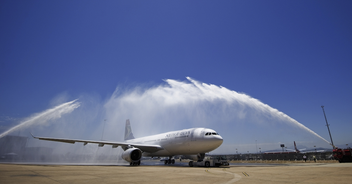 The first of the six new South African Airways (SAA) Airbus A330-200 long-range jetliners is sprayed with water to mark its first landing in Cape Town on February 8, 2011. South African MP Dirk Feldman got hosed while flying to India on an official visit, and drunkenly tried to open the SAA plane door mid-flight.</p>