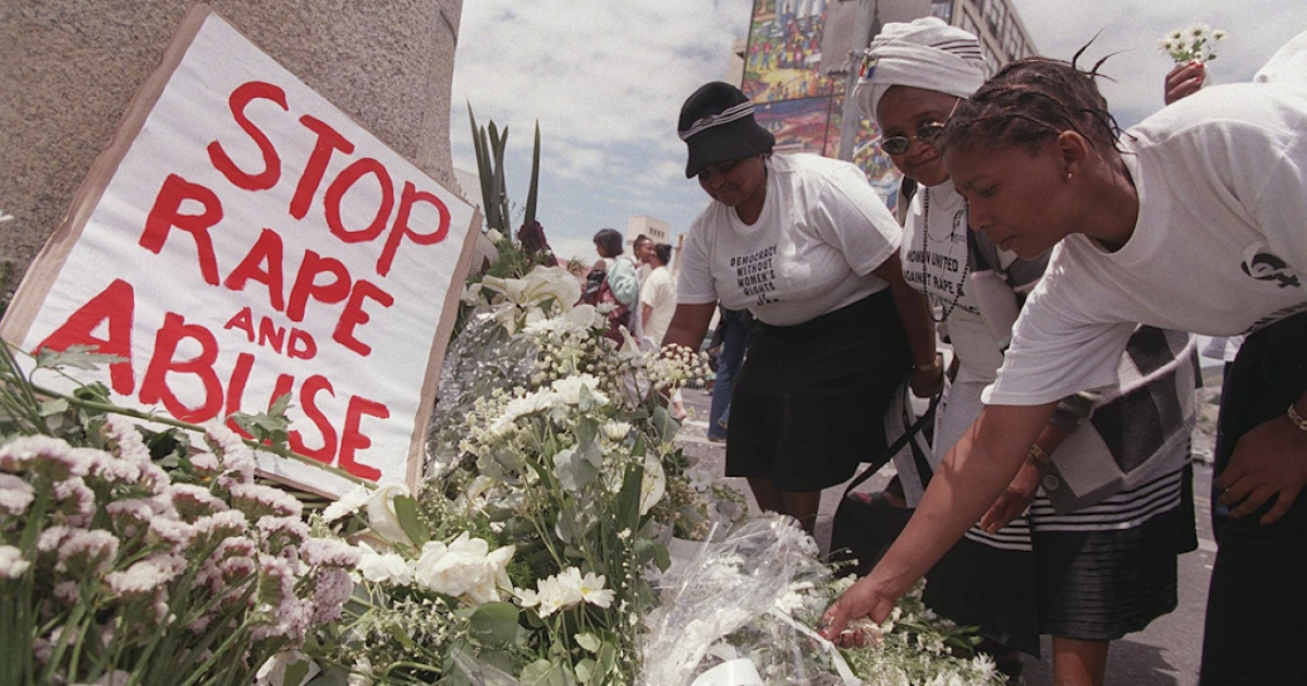 Women place white flowers outside parliament during a demonstration in Cape Town on the International Day for the Prevention of Violence against Women. South Africa has one of the highest rates of rape in the world.</p>
