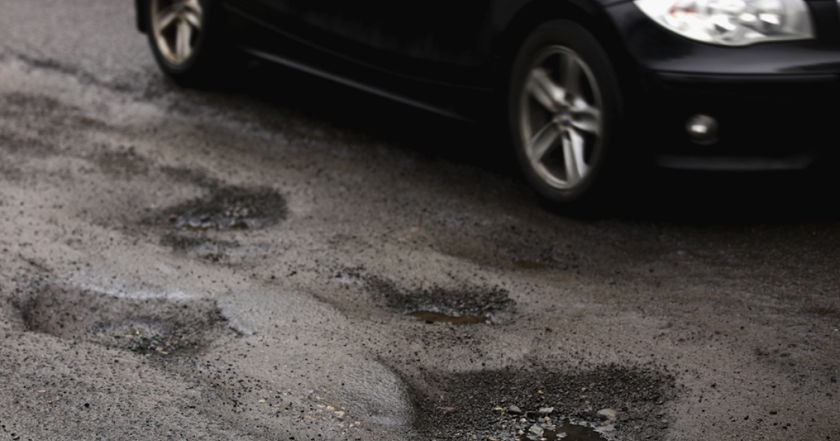 Potholes, the bane of motorists the world over.</p>