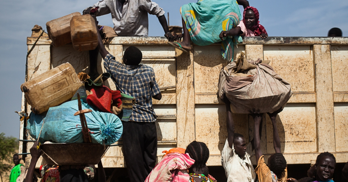 Nubans pile onto the back of a truck heading towards Yida refugee camp in South Sudan. The numbers of Sudanese  arriving at Yida is dramtically increasing each week, according to medics working at the camp.</p>