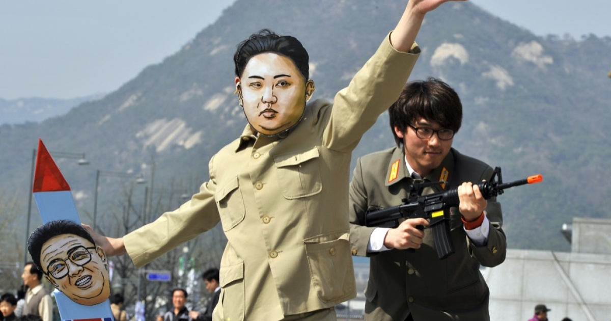 A South Korean activist (C) wearing a mask of North Korean leader Kim Jong Un holds a mock missile during a rally denouncing North Korea's rocket launch and the three-generational dictatorship, in Seoul on April 15, 2012. Has normal electoral rules applied, tensions with the North, plus renewed concern over Pyongyang's missile and nuclear programs, would normally have benefited the opposition. But as signs of an opening up emerge under the North Korea's new leader Kim Jong Un, the appetite south of the border could be for a leader more willing to re-open the door to aid and dialog.</p>