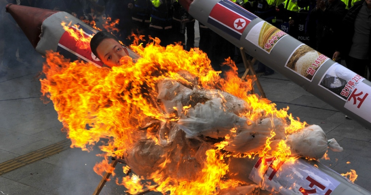 South Korean protesters set fire to a mock North Korean missile carrying an effigy of the country's leader Kim Jong-Un last Friday when Pyongyang admitted that its long-range rocket launch had failed.</p>