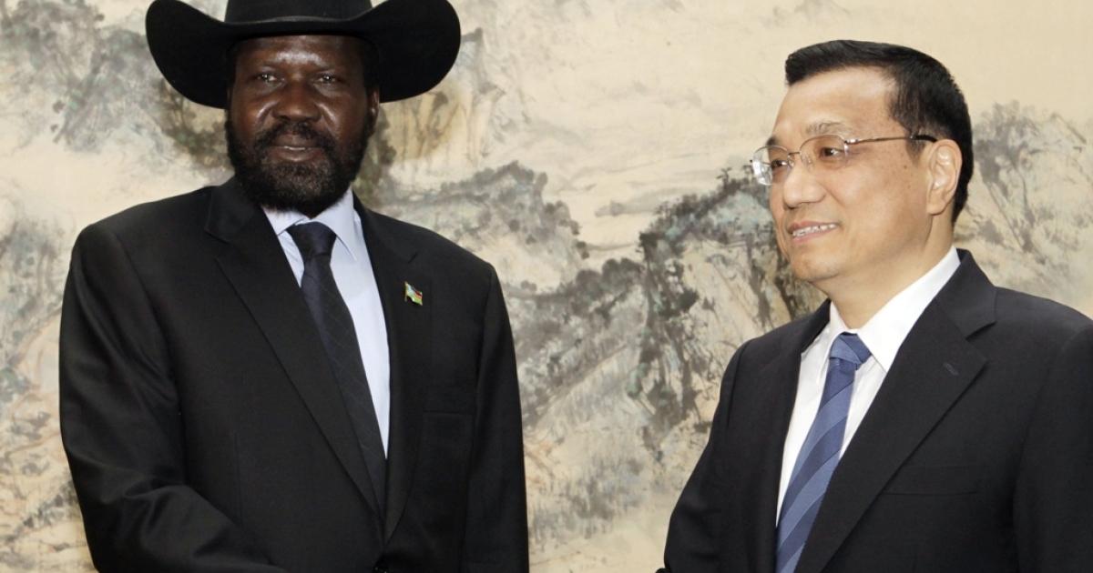 South Sudan president Salva Kiir shakes hands with Chinese Vice Premier Li Keqiang at Zhongnanhai on April 25, 2012 in Beijing, China. Kiir cut short his visit to China due to increasing tensions with neighboring Sudan.</p>
