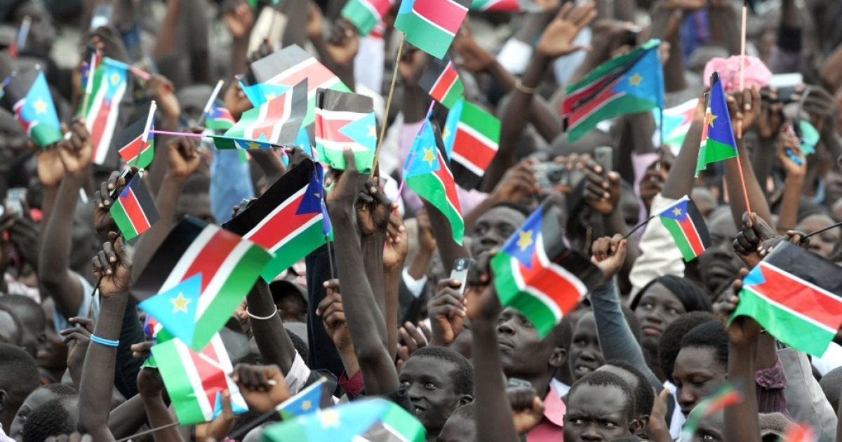 South Sudanese wave the flag of their new country in the capital Juba on July 9, 2011 to celebate the nation's independence from Sudan. South Sudan separated from Sudan to become the world's newest nation.</p>