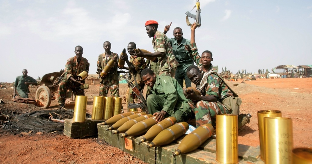 Sudanese soldiers pose next to seized mortar rounds from the Sudanese Peoples Liberation Army (SPLA) of South Sudan in the oil region of Heglig on April 23, 2012. Sudanese President Omar al-Bashir said during his visit to Heglig that there will be no more talks with South Sudan after weeks of border fighting in contested regions and tension between the two states.</p>