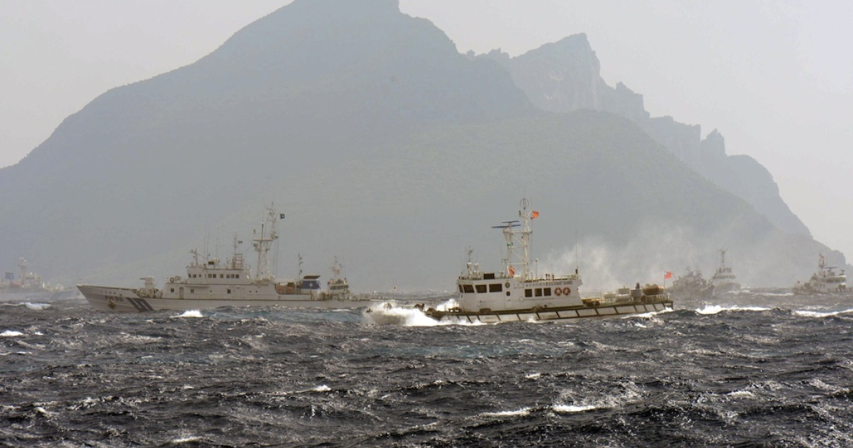 A Taiwan Coast Guard boat (R-with red flag) is blocked by a Japan Coast Guard vessel (L) in the waters near the disputed Diaoyu / Senkaku islands in the East China Sea. Both Japan and Taiwan want use of the islands. The Chinese may have seen all this action from above with new drones that will be used to monitor the islands and the areas around them, which China believes are theirs.</p>