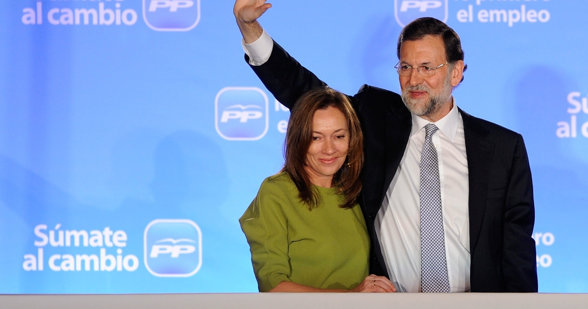 Mariano Rajoy, leader of the Popular Party, is accompanied by his wife Elvira Fernandez as he addresses party supporters in Madrid after winning the Spanish general elections on Nov. 20, 2011.</p>