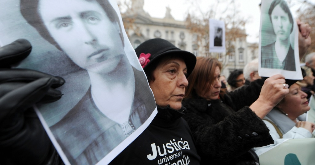 Protesters hold pictures of deceased relatives during Spain's 1936-39 civil war during a demonstration in support of Spanish Judge Baltasar Garzon on January 13, 2012 in Madrid. In May last year Garzon was suspended from his job pending trial for abuse of power after he opened a probe into the disappearance of tens of thousands of people during Spain's 1936-39 civil war and General Francisco Franco's subsequent right-wing dictatorship.</p>