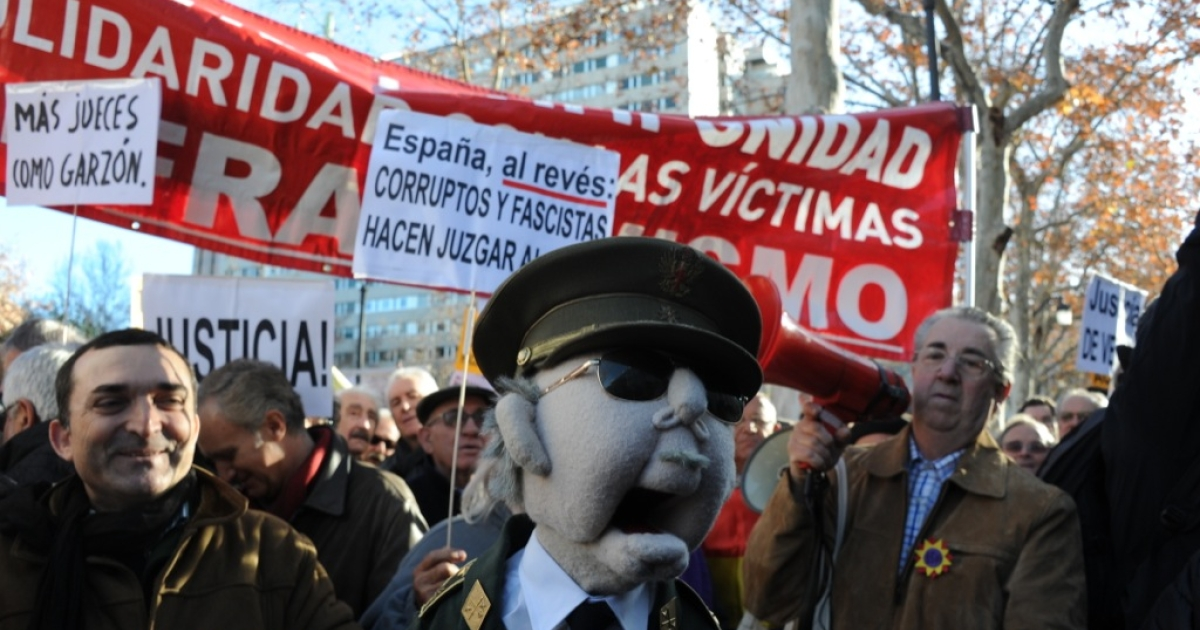 A protestor holds a muppet of Franco on Jan. 24, 2012 during a demonstration in support of Spanish Judge Baltasar Garzon in front of the Spanish Supreme court in Madrid. About 200 supporters of Garzon gathered outside Madrid's Supreme Court as the case against him for ordering an investigation into the disappearance of 114,000 people during Spain's 1936-39 civil war and Franco's subsequent dictatorship started being heard.</p>