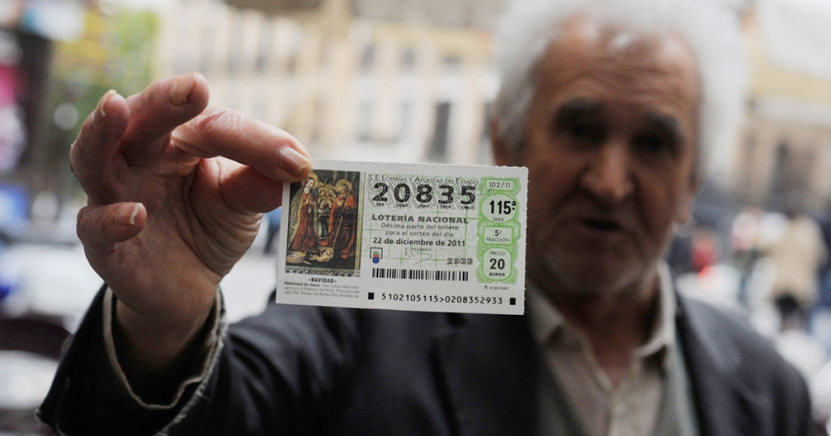 A man holds a Christmas lottery ticket for the