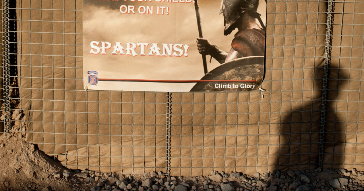 A concrete blast wall with spartan banner.</p>