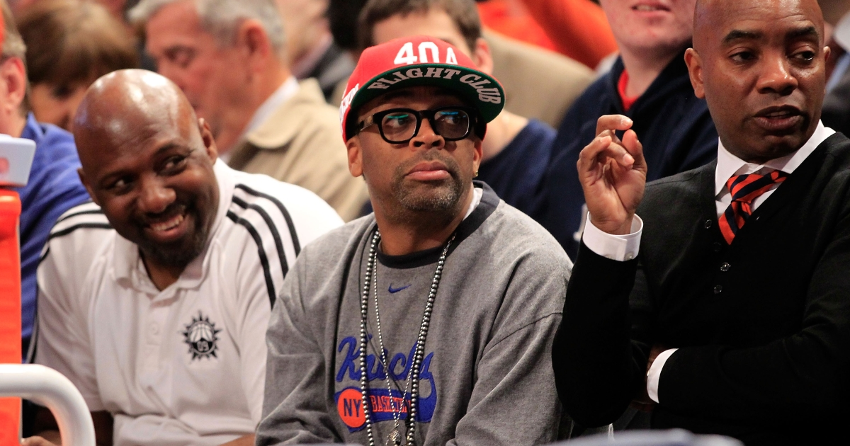 Spike Lee looks on as the Syracuse Orange play the Cincinnati Bearcats during the semifinals of the Big East men's basketball tournament at Madison Square Garden in New York on March 9.</p>