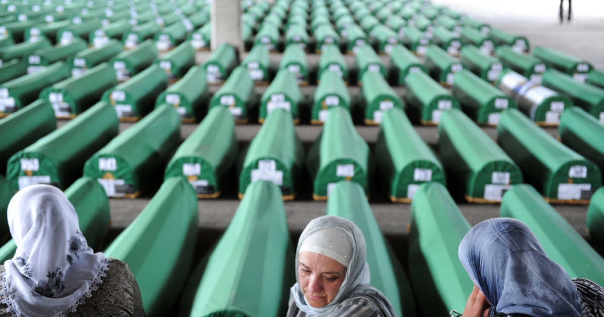 Bosnian muslim women cry among 520 caskets awaiting a mass burial ceremony at the Srebrenica Memorial Cemetery, on July 10, 2012. Some 8,000 Muslim men and boys were killed in just a few days after the eastern town under UN protection was captured by Bosnian Serb forces in July 1995; on Sept. 6, 2013, a court ruled that Dutch peacekeepers could have saved at least three of them.</p>