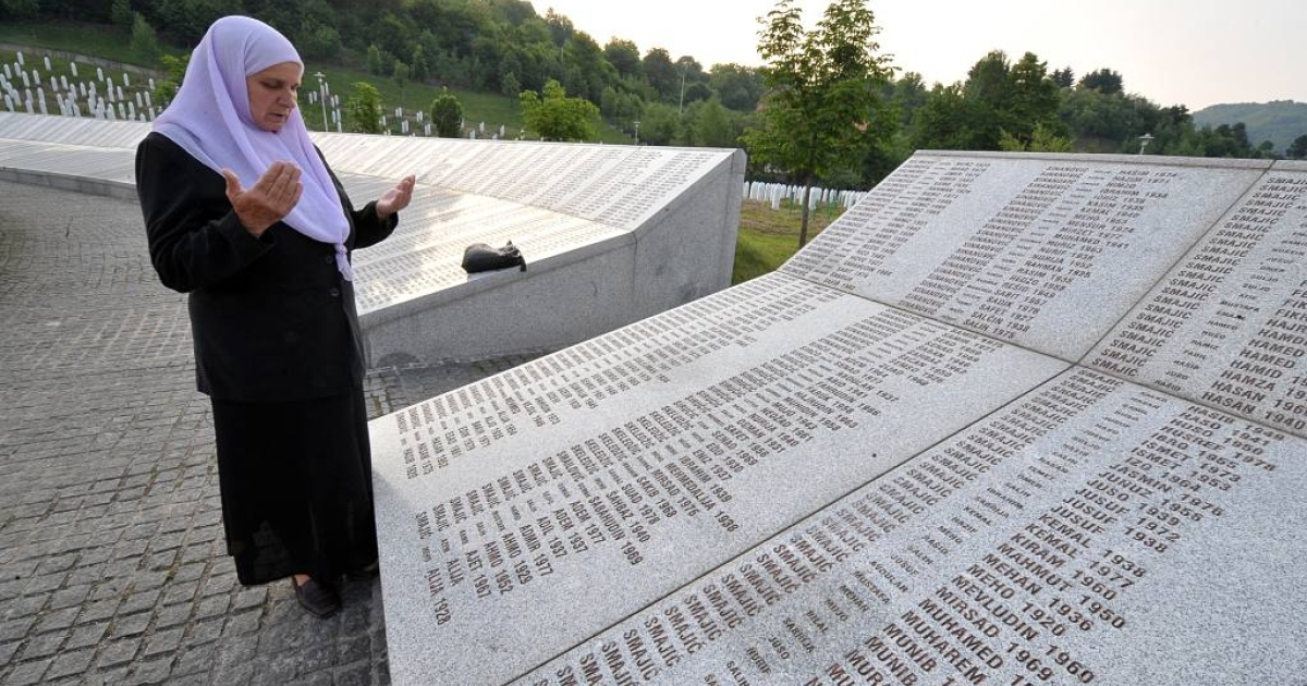 A Bosnian Muslim survivor of the Srebrenica massacre of 1995 prays in front of the memorial wall of victims of the atrocity. A court decision determined that the Dutch UN troops compensate the families of three slain Bosnian Muslim men.  The Dutchbat was supposed to protect these men but instead handed them over to the Bosnian Serbs.</p>