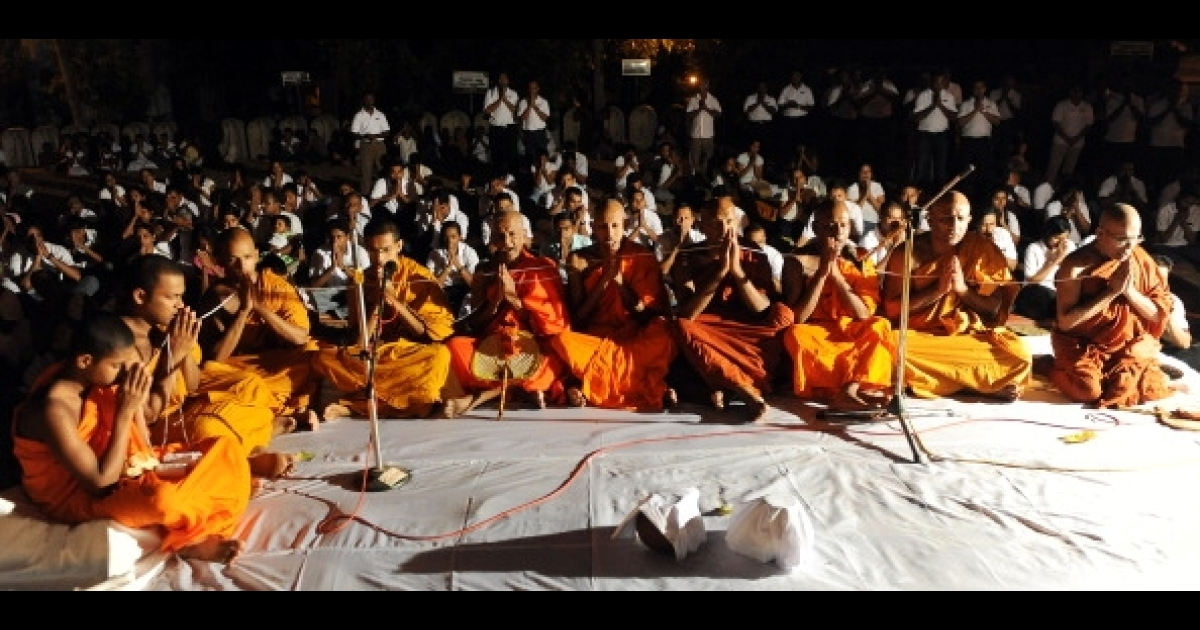 Sri Lankan Buddhist monks offer special prayers to bless the national cricket team at the Kelaniya Temple in Kelaniya on April 1, 2011.</p>