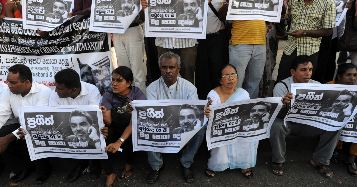 Media rights activists hold up posters of missing Sri Lankan cartoonist Prageeth Eknaligoda during a protest rally in Colombo on January 24, 2012. Eknaligoda disappeared on January 24, 2010, just hours before the presidential election. Rights groups have repeatedly accused the government of stifling media freedoms.</p>