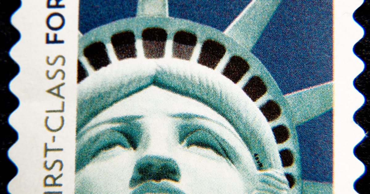 A close-up of a Statue of Liberty postage stamp.</p>
