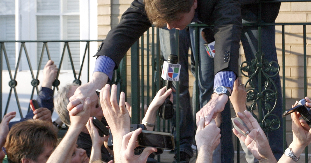 Disgraced former Illinois Governor Rod Blagojevich shakes hands with supporters after giving a news conference outside his home March 14, 2012 in Chicago. Blagojevich must report to a federal prison in Colorado by tomorrow, to start serving a 14-year term he received for his conviction on numerous counts of fraud and corruption including attempting to sell the vacant U.S. Senate seat held by then Senator Barack Obama.</p>