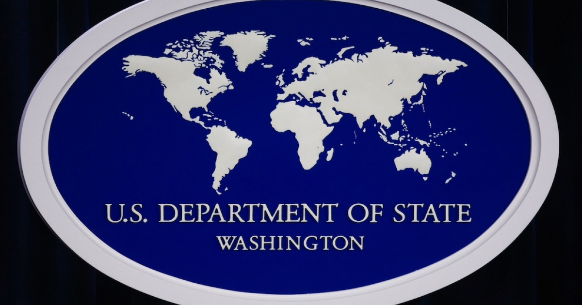 The US Department of State logo inside the media briefing room at the US Department of State in Washington, DC.</p>