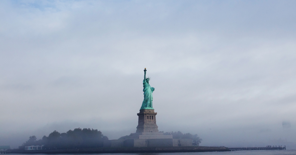 The Statue of Liberty seen through fog before the 125th Anniversary of the Statue of Liberty ceremony on Liberty Island in New York City, Sept. 22, 2011.</p>
