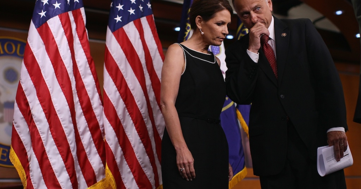 Former Republican presidential candidate and US Representative Michele Bachmann confers with US Rep. Steve King during a news conference on July 13, 2011 in Washington, DC. King said Friday he plans to sue Obama over his new immigration policy.</p>