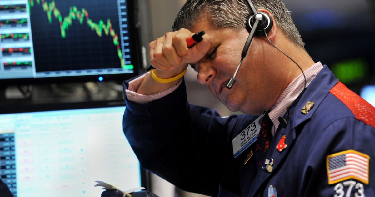 Trader John W. Panin of JNK Securites Corp. works on the floor of the New York Stock Exchange on August 4, 2011.</p>