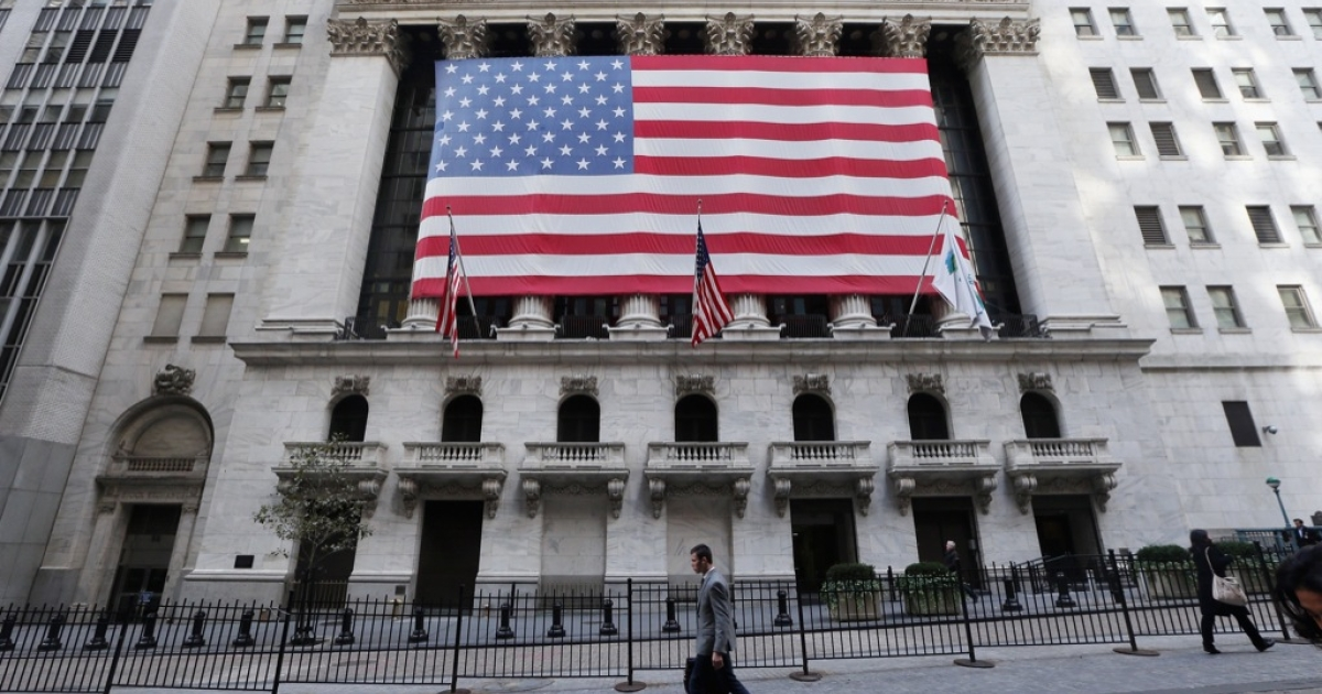 A man walks in front of the normally bustling New York Stock Exchange after the opening bell on November 5, 2012 in New York City.</p>